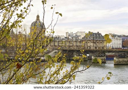 Love padlocks on the bridge Pont des Arts across river Seine in Paris. - stock photo