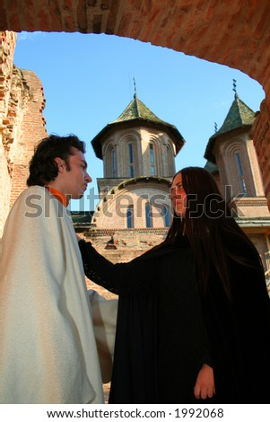 Love prince and princess in a medieval place with tower - stock photo