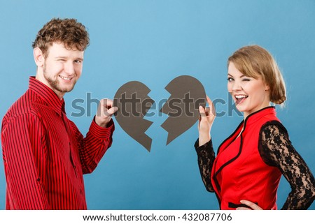 Love romance heartbreak sadness anguish making up reconcillation concept. Smiling couple fixing heart. Man with woman smiling holding two halves.