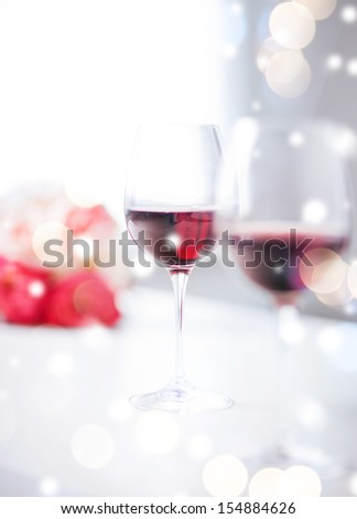 love, romance, holiday, celebration concept - wine glasses on the table in restaurant - stock photo