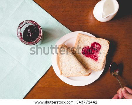 Love sign on Whole wheat breads on dish with mulberry jam