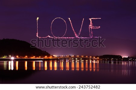 Love sparkle Fireworks celebrating over bridge of Lake Kawaguchiko at night with mount Fuji background, Japan - stock photo