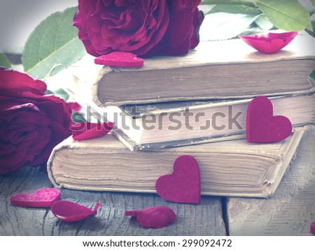Love Stories, old books in retro arrangement - stock photo