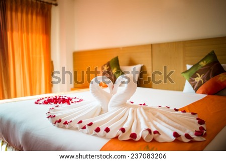 love swans and rose decoration in hotel, towel wedding decoration, love, couple, resort - stock photo