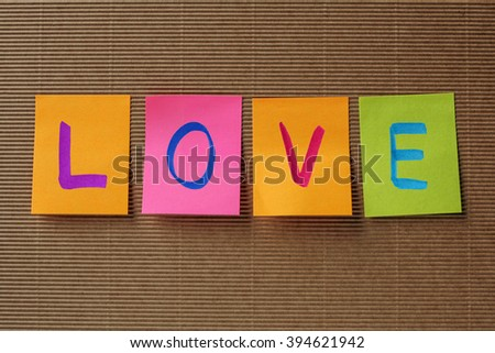 love text on colorful sticky notes - stock photo
