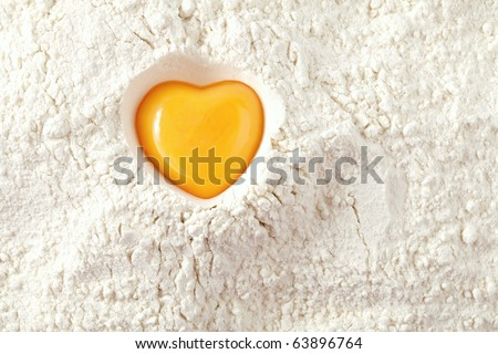 love to bake it!  egg  yolk on flour, full frame - stock photo