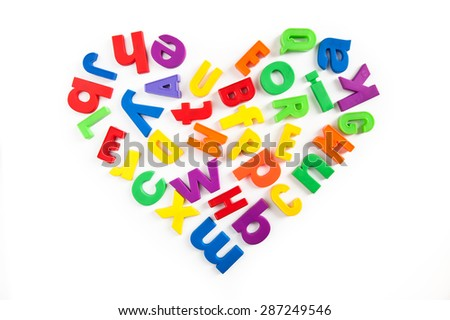 Love to learn. Heart shape made of colorful magnetic fridge letters. - stock photo