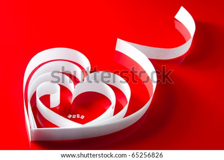 """Love valentine heart. White paper ribbon heart with letters """"Love"""" inside on red - stock photo"""