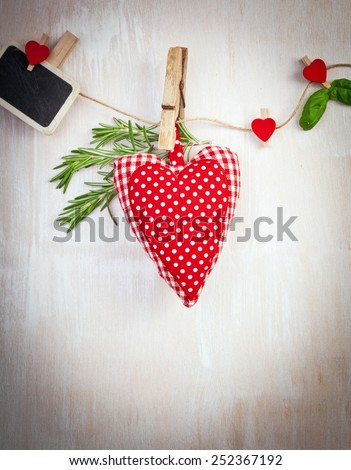 Love Valentine's hearts natural cord and red clips on rustic texture background, copy space - stock photo