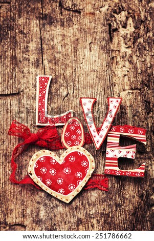 Love valentines day background, letters forming word LOVE written on wooden background - stock photo