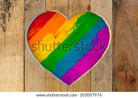Love Valentines heart wooden frame from recycled old palette with pride rainbow colours  background, copy space - stock photo