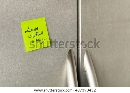 Love will find a way sticky note on a home refrigerator.