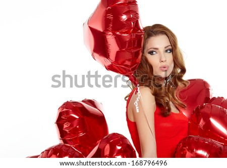 Love woman smiling holding red heart shaped balloon.  - stock photo