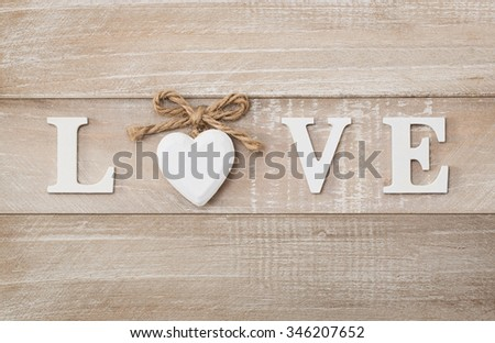 Love wooden text on vintage board background with copy space - stock photo