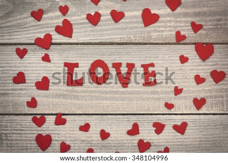 Love word in the surrounding of felt hearts - stock photo