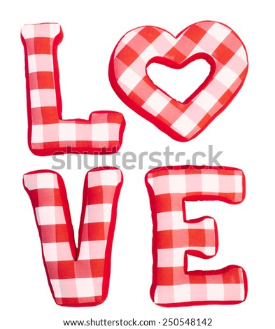 Love word of plush red letters on white isolated background. Full plaid textile. February 14, Valentine's Day concept shot with text space. Top view. High resolution - stock photo