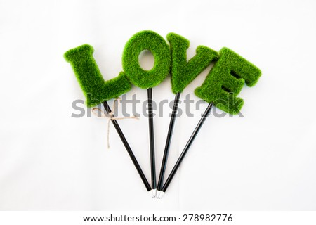 Love wording head pencil on white background - stock photo
