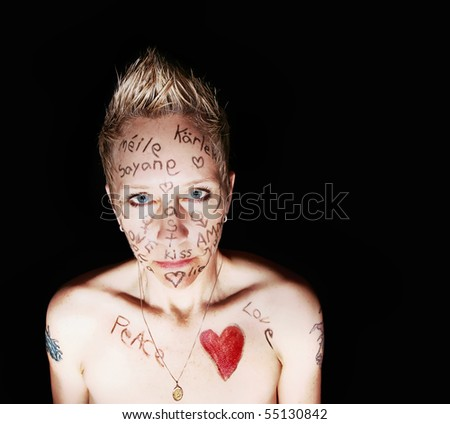 love written on a woman's face in different languages - stock photo