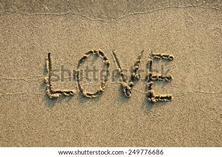 LOVE written on beach.  - stock photo