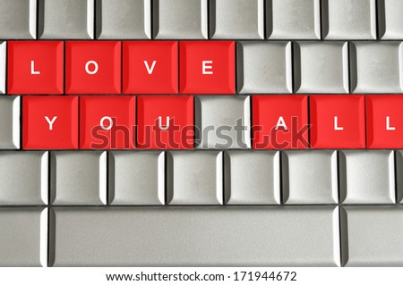 Love you all  spelled on metallic keyboard - stock photo