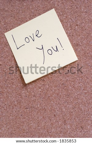 LOVE YOU note on a bulletin board - stock photo