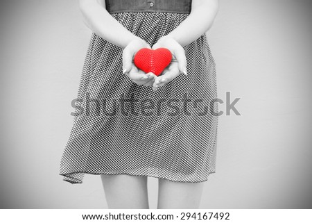 love young girl heart in hand black and white photo Vintage retro style - stock photo