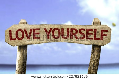 Love Yourself wooden sign with a beach on background - stock photo