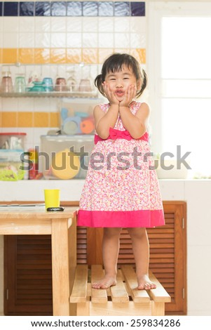 lovely acting of little children dinning table in home kitchen room use for happiness in people family - stock photo