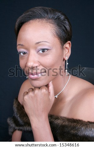 Lovely african american woman in a fur - stock photo