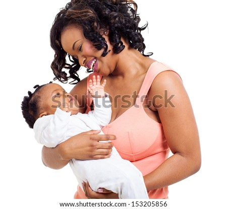 lovely african woman holding her baby girl isolated on white - stock photo