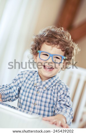 Lovely baby boy wearing glasses. Little genius, scientist - stock photo
