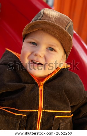 Lovely Baby Boy with beautiful blue eyes in the park
