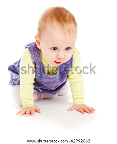 Lovely baby girl crawling, isolated