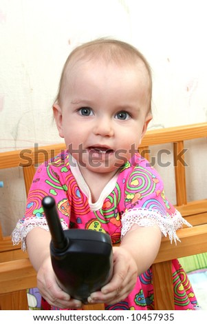 lovely baby girl in pink dress with phone