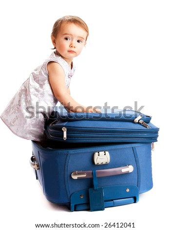 Lovely baby inside the suitcase - stock photo