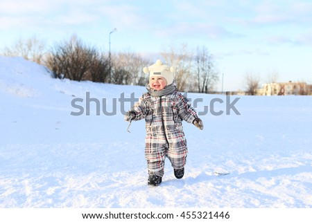 lovely baby running outdoors in winter