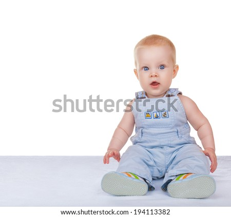 Lovely baby sitting on the floor isolated on white background - stock photo