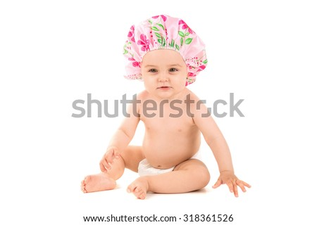 Lovely baby with shower cap isolated in white - stock photo