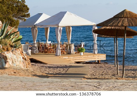 Lovely beach restaurant near crystal blue sea in Greece