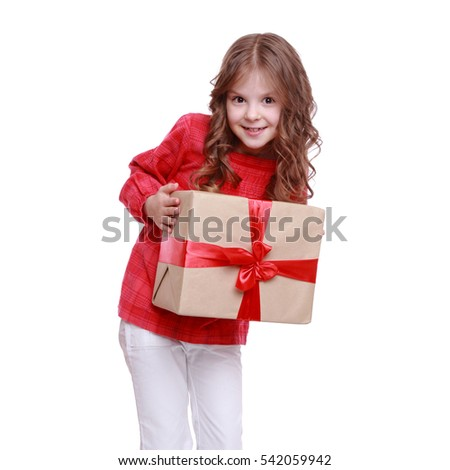 Lovely beautiful little girl holding present box isolated on white on Holiday theme/Portrait of cute little girl with gift box