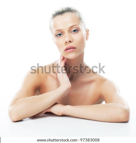 Lovely beautiful woman's face with fresh clean smooth skin - isolated on white background - stock photo