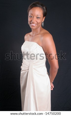 Lovely black woman in white formal dress - stock photo