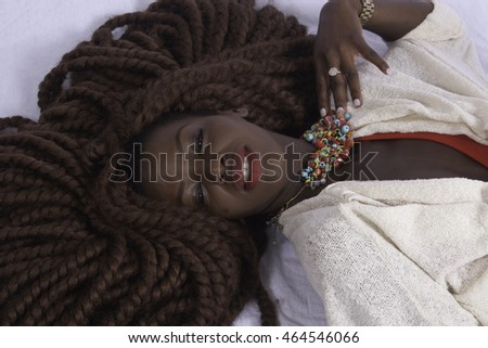 Lovely black woman  reclining with a smile