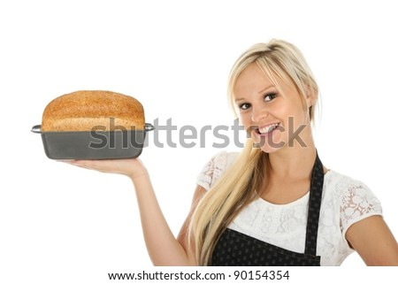 Lovely blond baker woman with a freshly baked loaf of bread - stock photo
