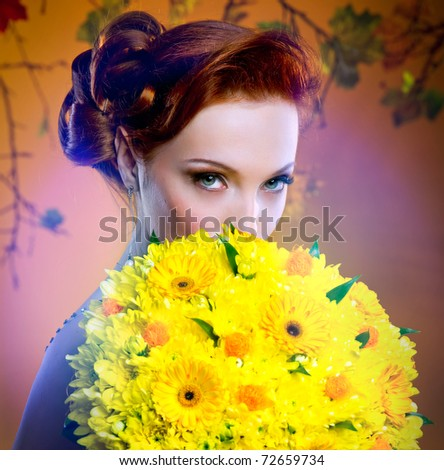 Lovely bride hiding behind luxury bouquet - stock photo