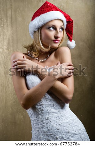 Lovely bride wearing christmas cap - stock photo