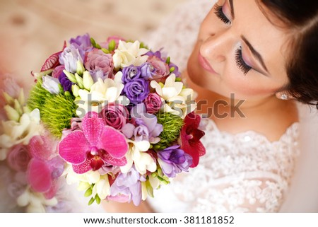Lovely bride with nice bouquet - stock photo