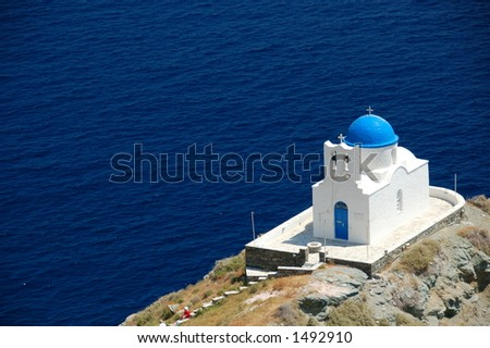 Lovely chapel by the sea front in Greece - stock photo