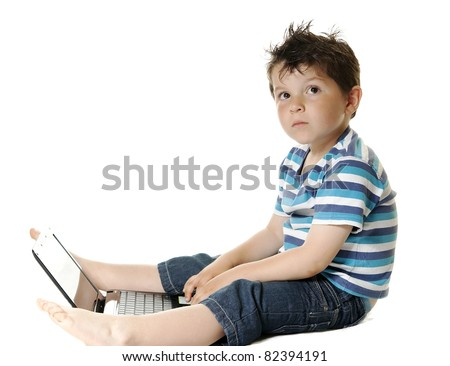 Lovely child isolated on a white background with a laptop