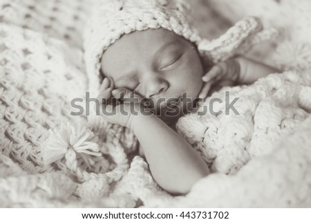lovely child lies with his mother - stock photo